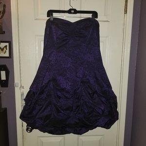 Torrid purple strapless dress.